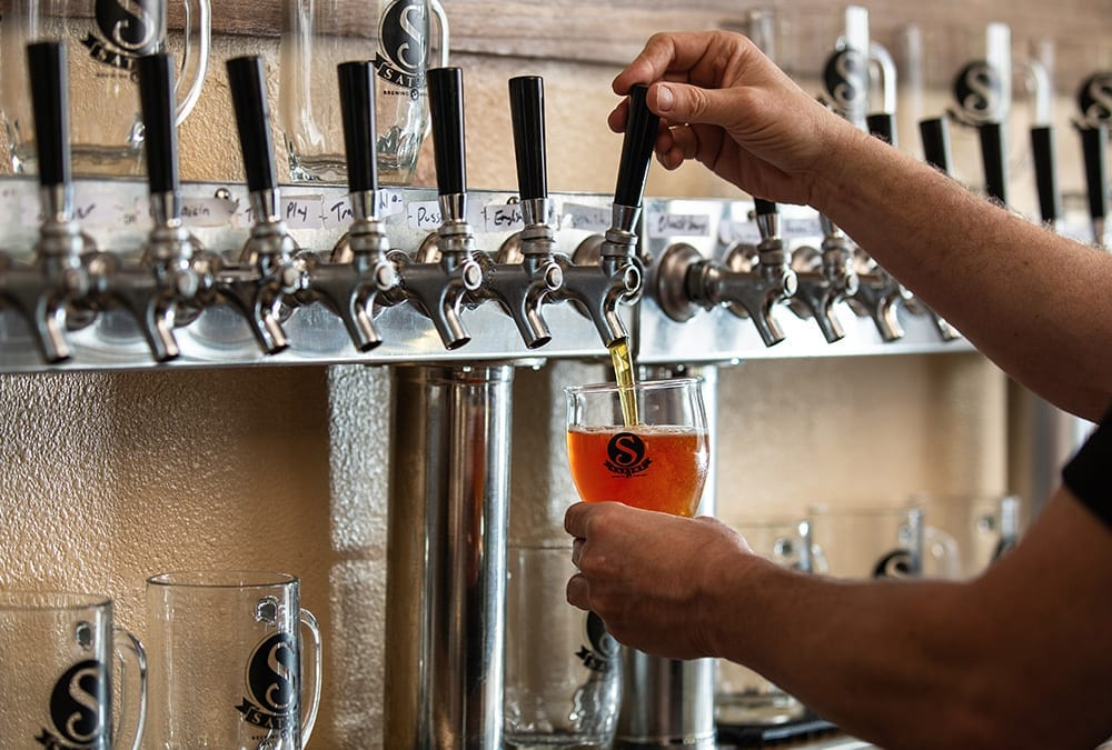 Satire Brewing Company - Beer Pouring From Tap By Bartender.