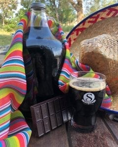growler of Pancho beer with chocolate bar and sombrero