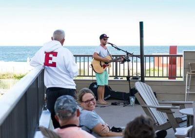 Harry's live performance on oceanfront rooftop deck.