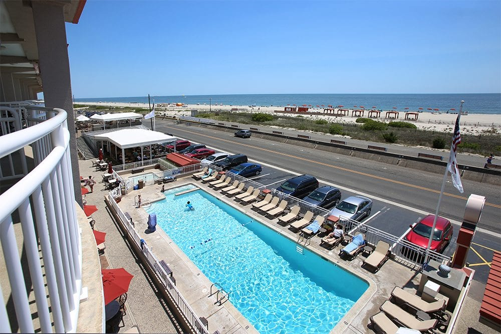 View of Montreal Beach Resort with oceanfront pool.