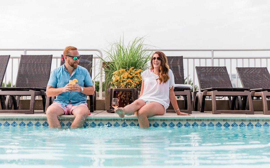 Couple dipping toes in pool at Montreal Beach Resort.