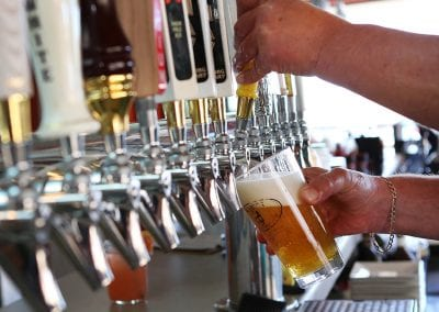 Closeup of bartender pouring beer at Harrys Bar Cape May