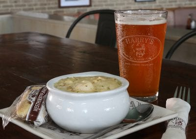 Bowl of clam chowder with pint of beer
