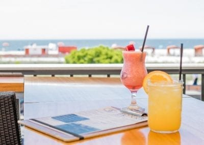 Image with tropical drinks on outside table