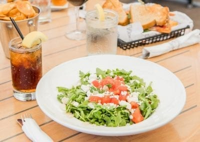 Harrys Salad image with ice tea drink.