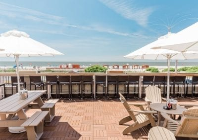 Outdoor image of Harrys rooftop deck. Overlooking ocean.