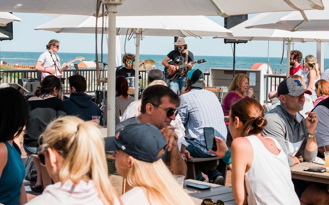 Harrys outdoor deck- live music with people sitting.