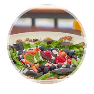 Decorative image with Harrys salad inside a round circle