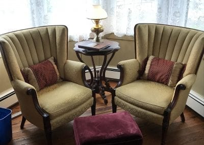 Queen Victoria Room Sitting Area with Beautiful Tufted Gold Chairs with Wood Trim