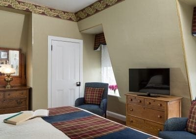 Crown Prince Guestroom Bedroom with TV, Closet, Antique Dresser and two beautiful windows
