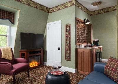 Crown Prince Guestroom Sitting Room with Electric Fireplace, big screen TV, wet bar and comfortable full length sofa