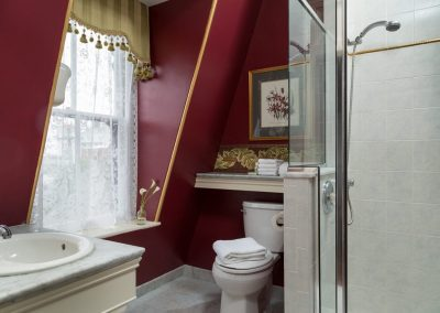 Crown Prince Guestroom Master Bath with step-in shower and marble top sink counter