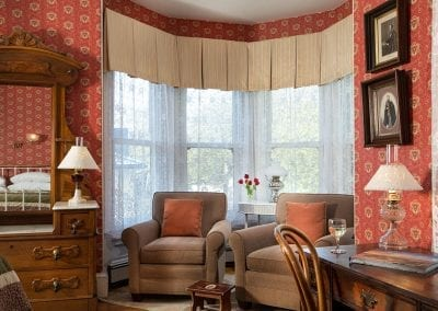 Prince Albert room bay window sitting area with two comfy upholstered chairs