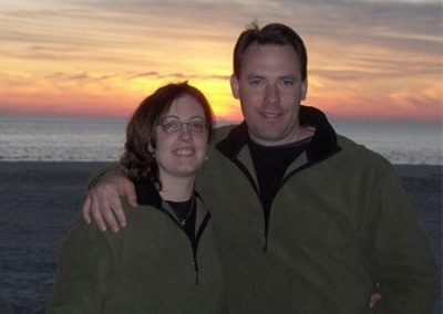 Guest Photos- Smiling couple at sunset near Cape May ocean.