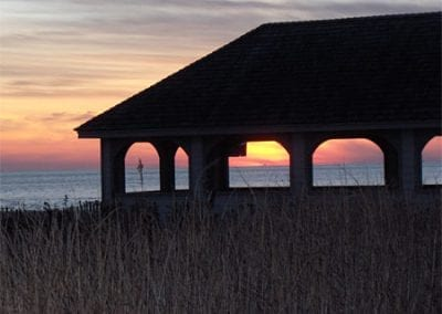 Cape May Nature- Sunset picture of building and beach.