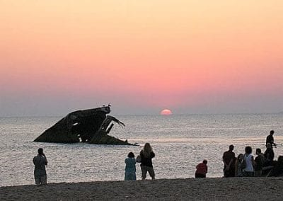 Cape May Activities- shipwreck sticking out of water at sunset.