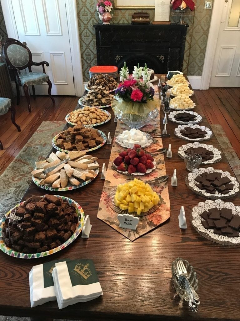 Dining Table with Vast Array of Chocolate Baked Treats, Fruit and Artisan Chocolates
