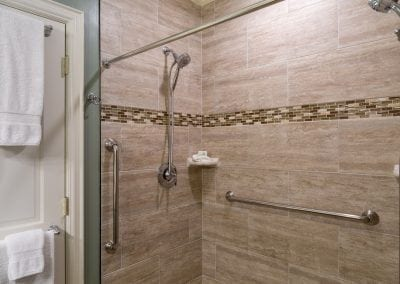 Lord Melbourne Guestroom Step-in Shower with 2 Shower Heads and 3 grab bars.