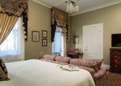 Lord Melbourne Guestroom with Camera Angle Showing the Entrance Door and Open Door to the Private Porch.